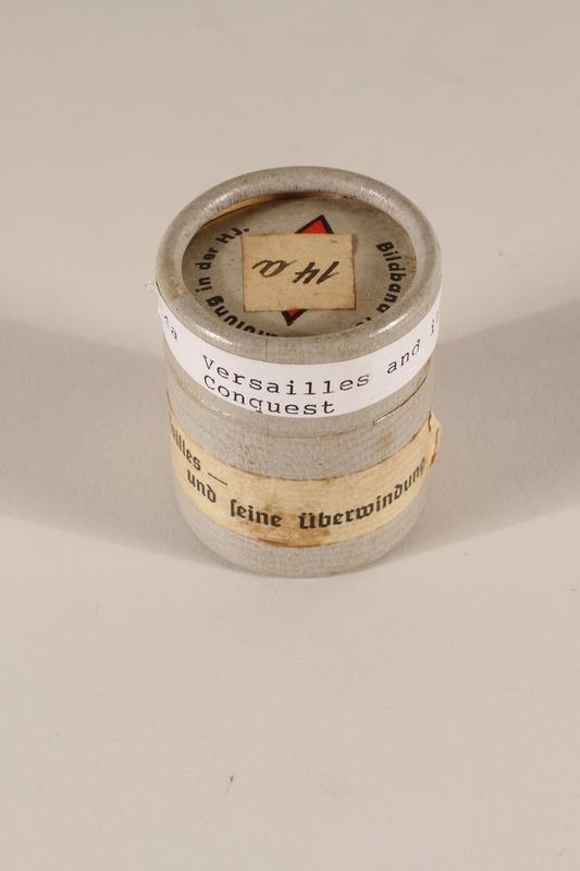 1996.77.12.2_a-b closed Nazi propaganda filmstrip canister