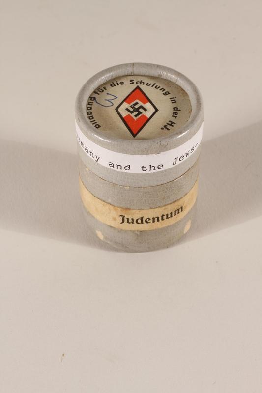 1996.77.4.2_a-b closed Nazi propaganda filmstrip canister