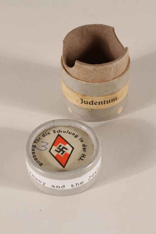 1996.77.4.2_a-b open Nazi propaganda filmstrip canister
