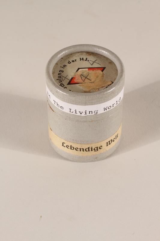1996.77.5.2_a-b closed Nazi propaganda filmstrip canister