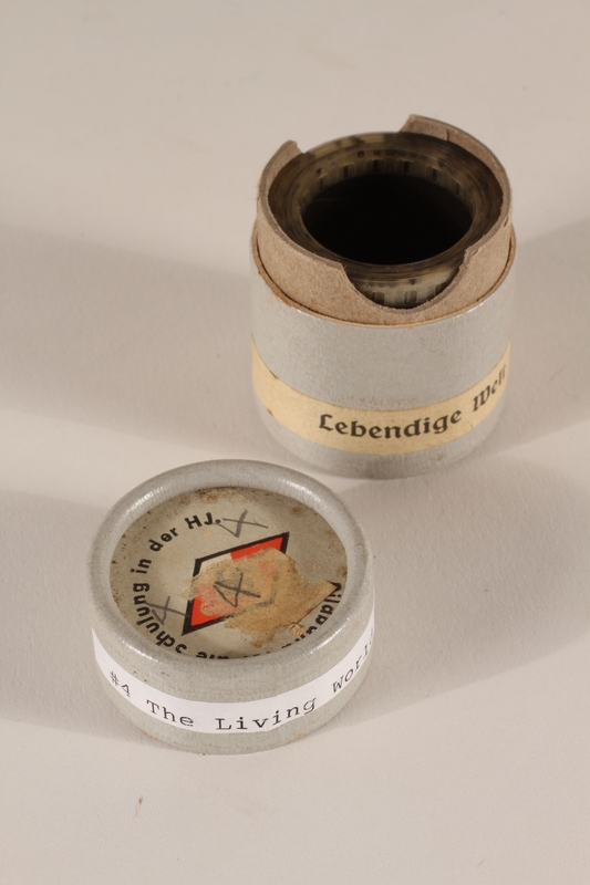 1996.77.5.2_a-b open Nazi propaganda filmstrip canister