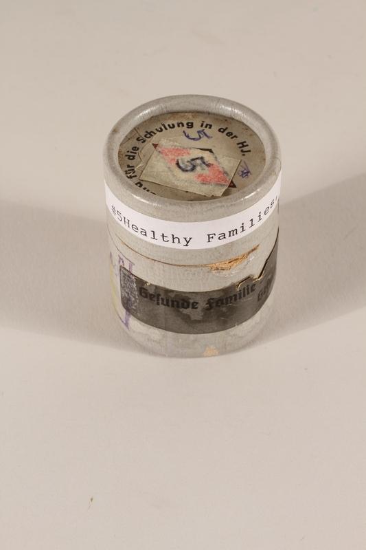 1996.77.6.2_a-b closed Nazi propaganda filmstrip canister