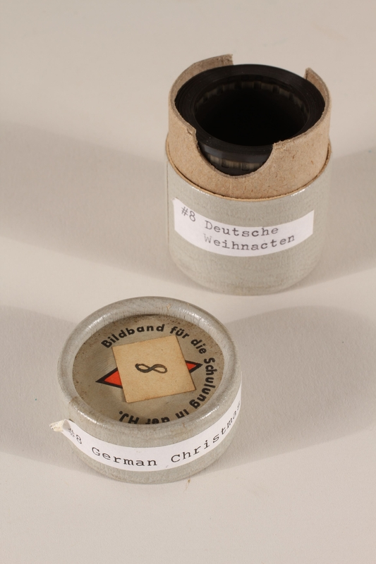 1996.77.9.2_a-b open Nazi propaganda filmstrip canister