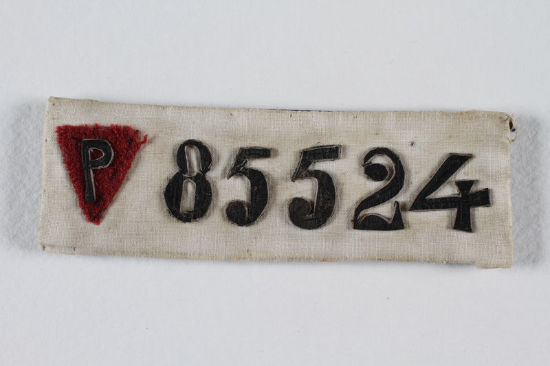 1996.93.1 front Prisoner identification badge