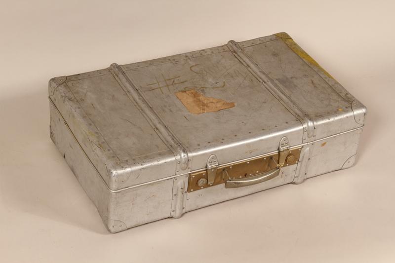 1997.102.1 front Aluminum suitcase used by Jewish Polish postwar refugees