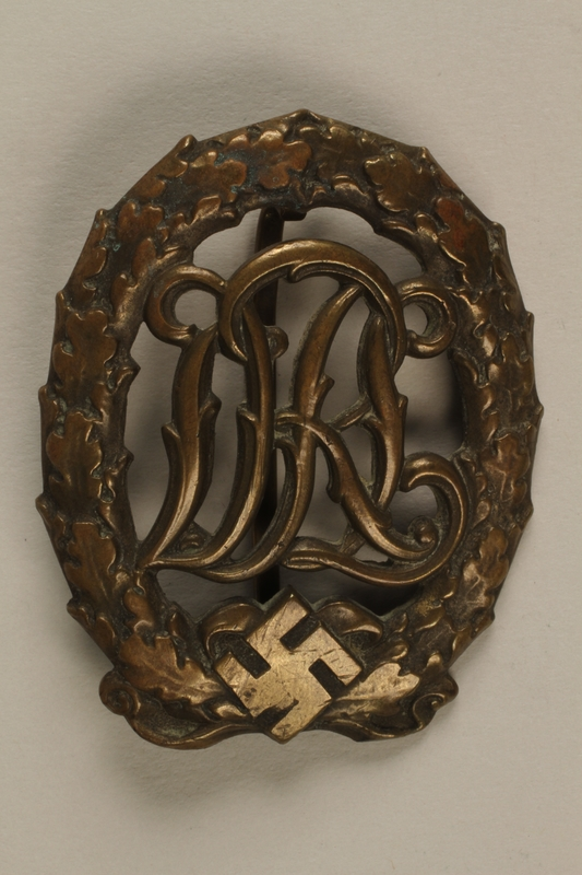 1997.105.2 front Bronze DRL sport badge awarded to those wounded during the war