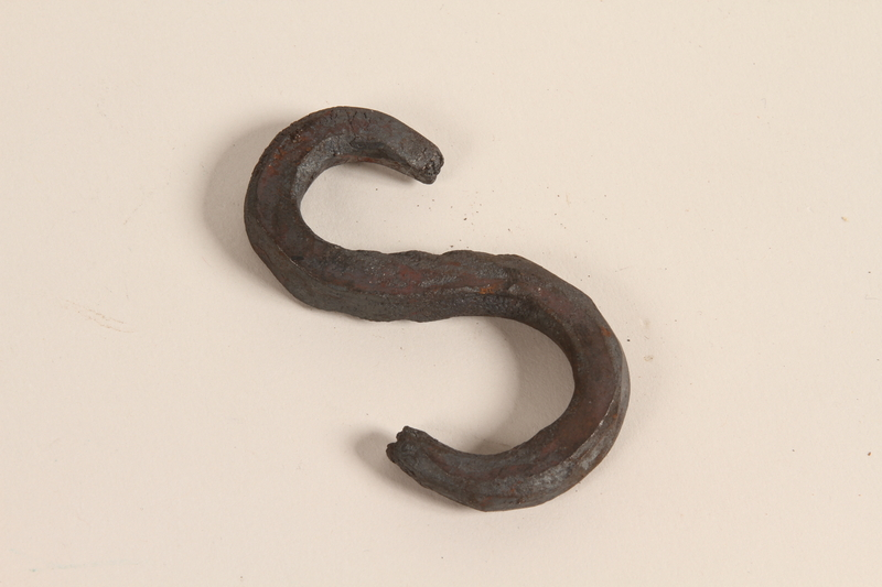 1989.332.5 front Blacksmith's S-hook used in a Romani encampment