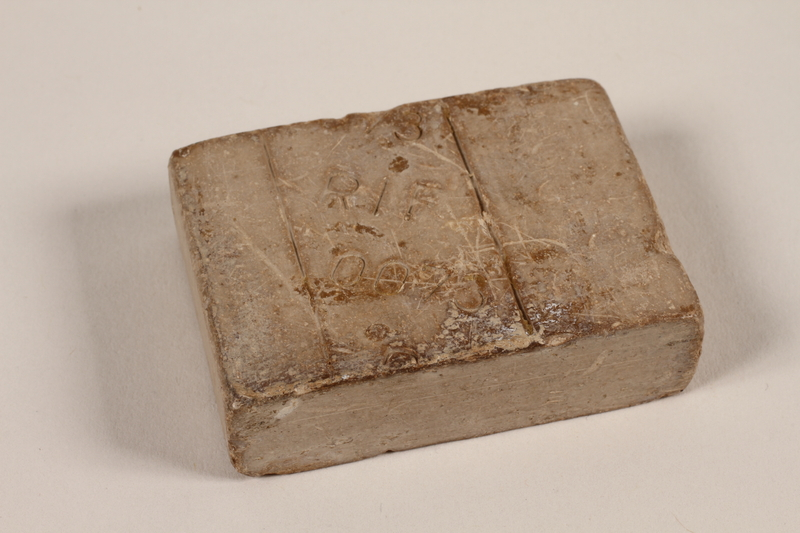 1997.112.2 front Bar of soap issued to a US soldier while held as a POW in a German Stalag