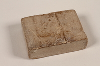 1997.112.2 front Bar of soap issued to a US soldier while held as a POW in a German Stalag  Click to enlarge