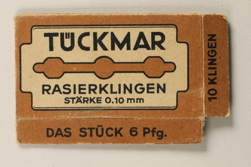 1997.112.6_a front Razor blades issued to a US soldier while held as a POW in a German Stalag