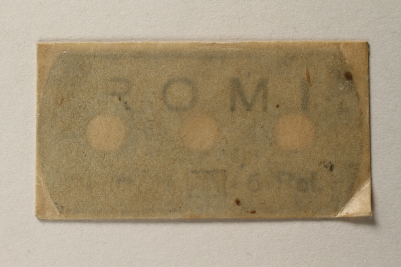 1997.112.6_b front Razor blades issued to a US soldier while held as a POW in a German Stalag