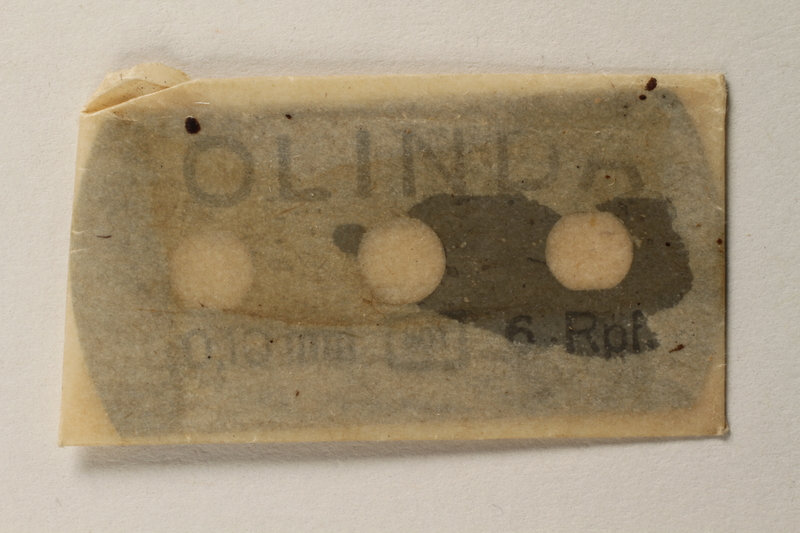 1997.112.6_c front Razor blades issued to a US soldier while held as a POW in a German Stalag