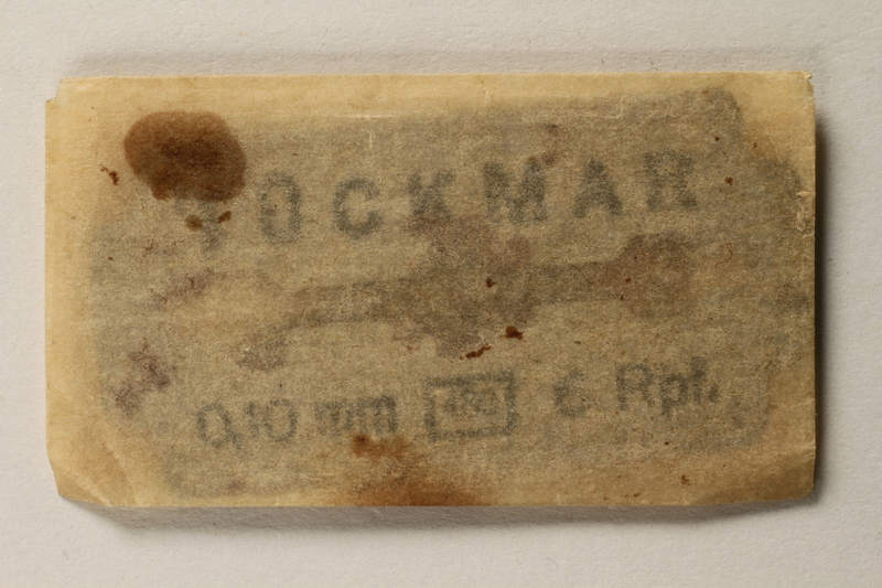 1997.112.6_d front Razor blades issued to a US soldier while held as a POW in a German Stalag