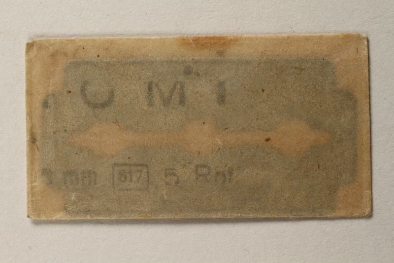 1997.112.6_e front Razor blades issued to a US soldier while held as a POW in a German Stalag