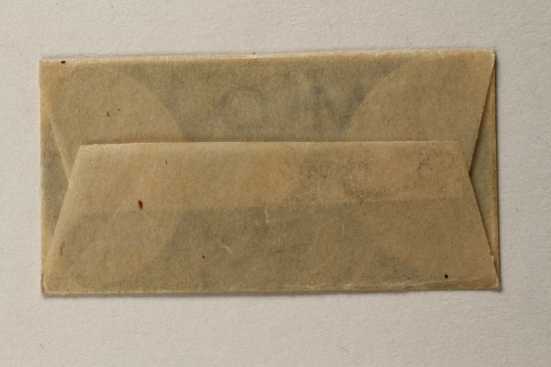 1997.112.6_f front Razor blades issued to a US soldier while held as a POW in a German Stalag