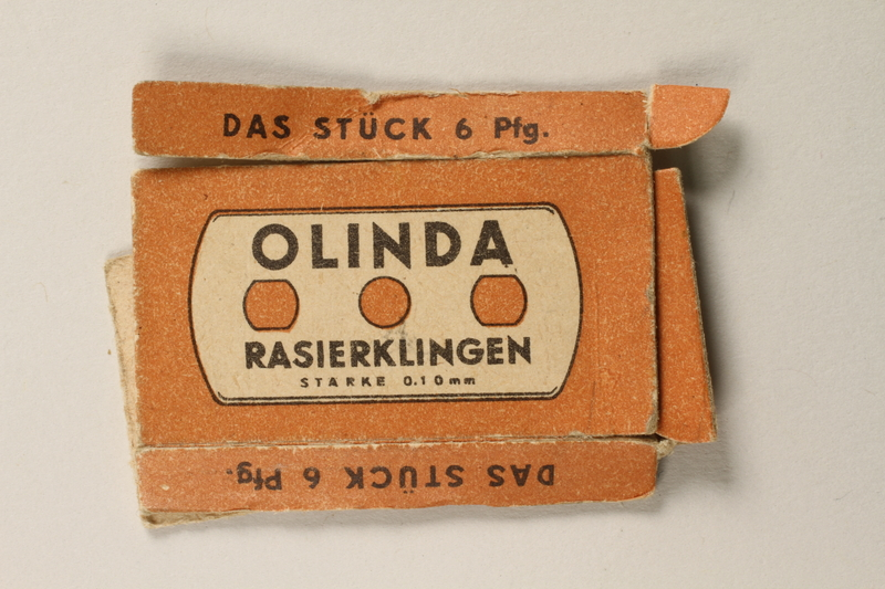 1997.112.7_a front Box of razor blades issued to a US soldier while held as a POW in a German Stalag