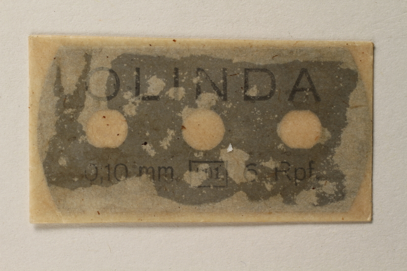 1997.112.7_b front Box of razor blades issued to a US soldier while held as a POW in a German Stalag