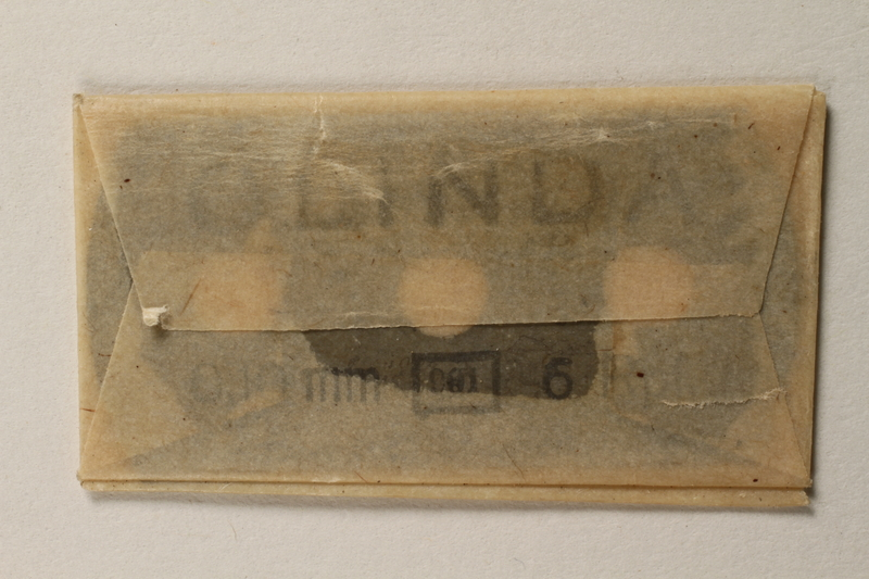 1997.112.7_c front Box of razor blades issued to a US soldier while held as a POW in a German Stalag