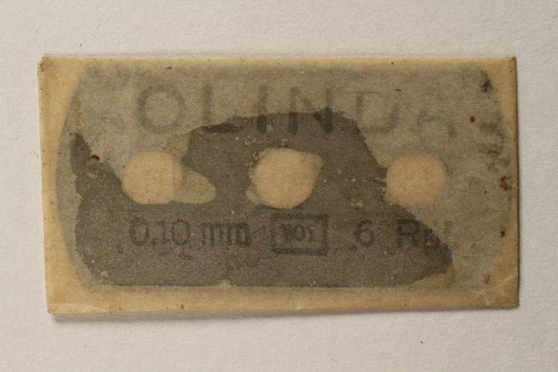 1997.112.7_e front Box of razor blades issued to a US soldier while held as a POW in a German Stalag