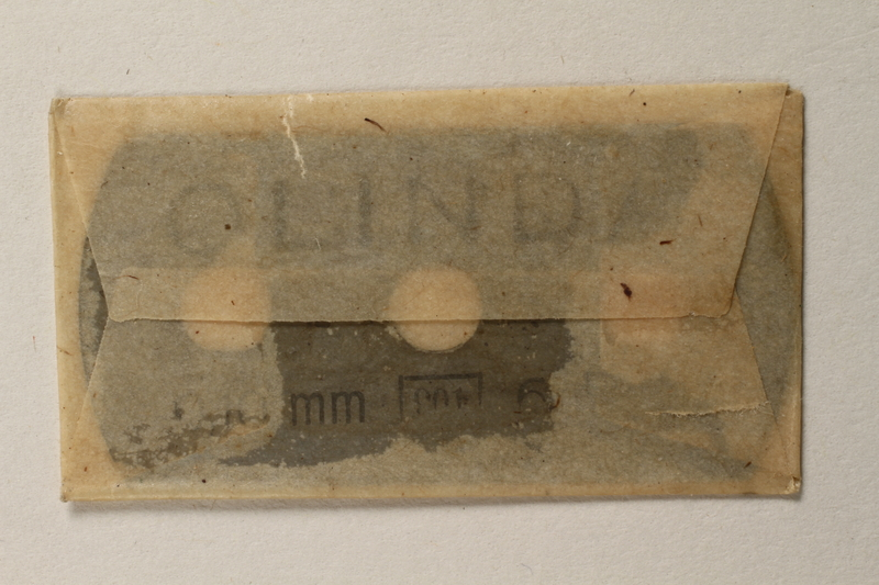 1997.112.7_f front Box of razor blades issued to a US soldier while held as a POW in a German Stalag