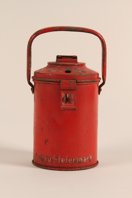 """1997.116.4 front Red """"Winterhilfe"""" collections canister"""