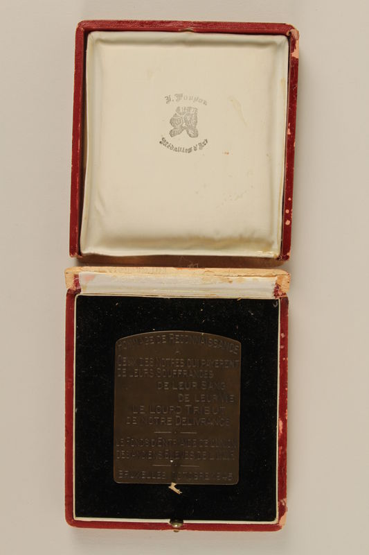 1997.20.3 open back Hommage de Reconnaissance Medal awarded posthumously