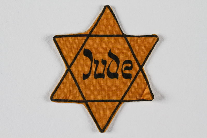 1997.3.2 front Star of David badge with Jude printed in the center
