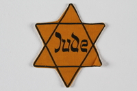 1997.3.2 front Star of David badge with Jude printed in the center  Click to enlarge