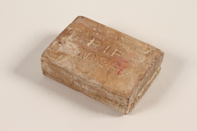 1997.30.2 front Bar of soap from Stutthof labor-concentration camp given to a Polish Holocaust survivor