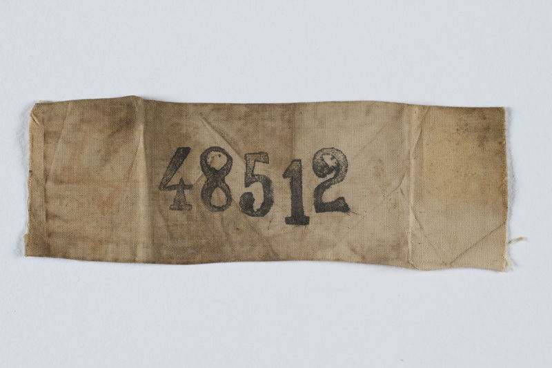 1997.31.1 front Rectangular Stutthof ID badge numbered 48512 worn by a Lithuanian Jewish inmate