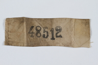 1997.31.1 front Rectangular Stutthof ID badge numbered 48512 worn by a Lithuanian Jewish inmate  Click to enlarge