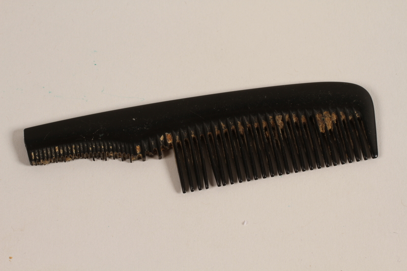 1997.31.2.2 front Broken fine tooth comb owned by a Lithuanian Jewish concentration camp inmate