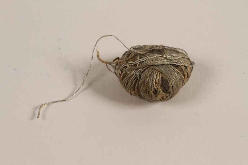 1997.31.2.3 front Wound ball of thread used by a Lithuanian Jewish concentration camp inmate