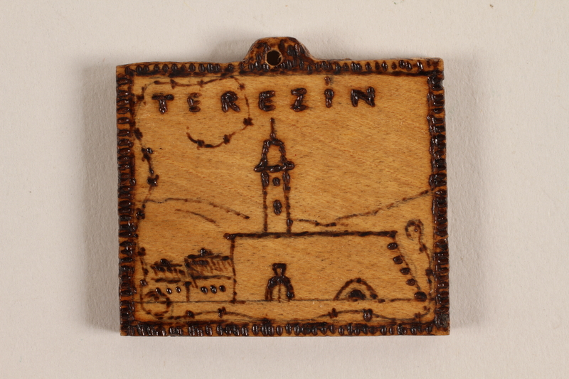 1989.342.1 front Small wooden tile with the Terezin church steeple made by a former Jewish Czech concentration camp inmate