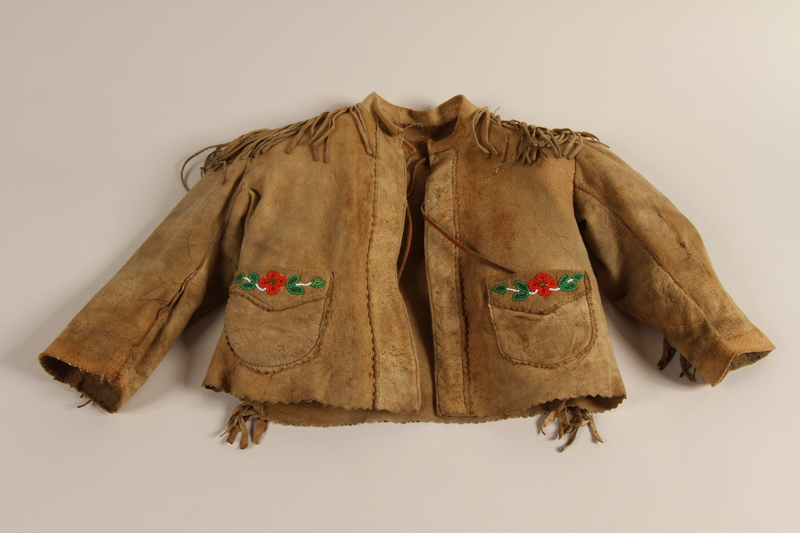 1997.81.1 front Fringed leather jacket with beaded design worn by a Jewish refugee child in Shanghai