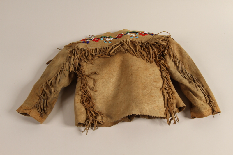 1997.81.1 back Fringed leather jacket with beaded design worn by a Jewish refugee child in Shanghai