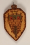 Small colored wooden pendant with the Terezin crest made by a former Jewish Czech concentration camp inmate