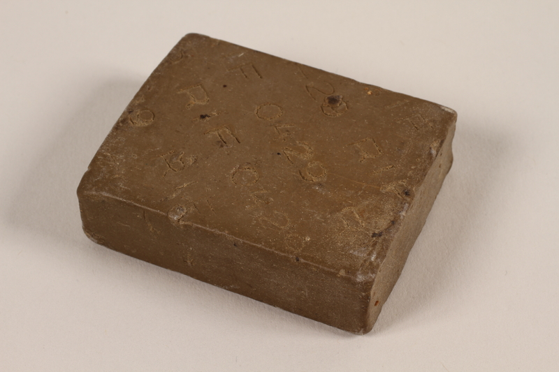 1997.89.1 front Bar of soap issued in a concentration camp