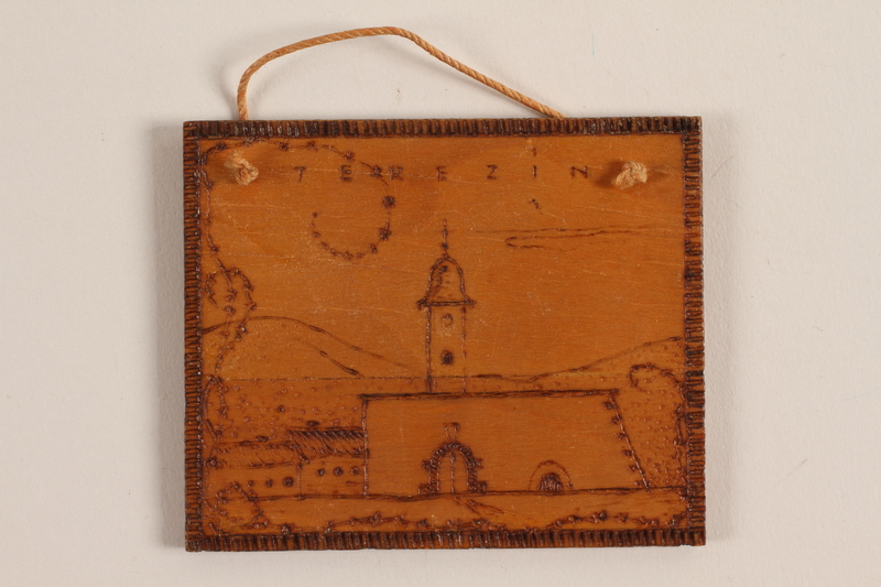 1989.342.12 front Small wooden tile with the Terezin church steeple made by a former Jewish Czech concentration camp inmate