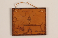 1989.342.12 front Small wooden tile with the Terezin church steeple made by a former Jewish Czech concentration camp inmate  Click to enlarge