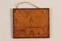Small wooden tile with the Terezin church steeple made by a former Jewish Czech concentration camp inmate