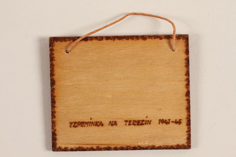 1989.342.12 back Small wooden tile with the Terezin church steeple made by a former Jewish Czech concentration camp inmate