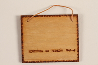 1989.342.12 back Small wooden tile with the Terezin church steeple made by a former Jewish Czech concentration camp inmate  Click to enlarge