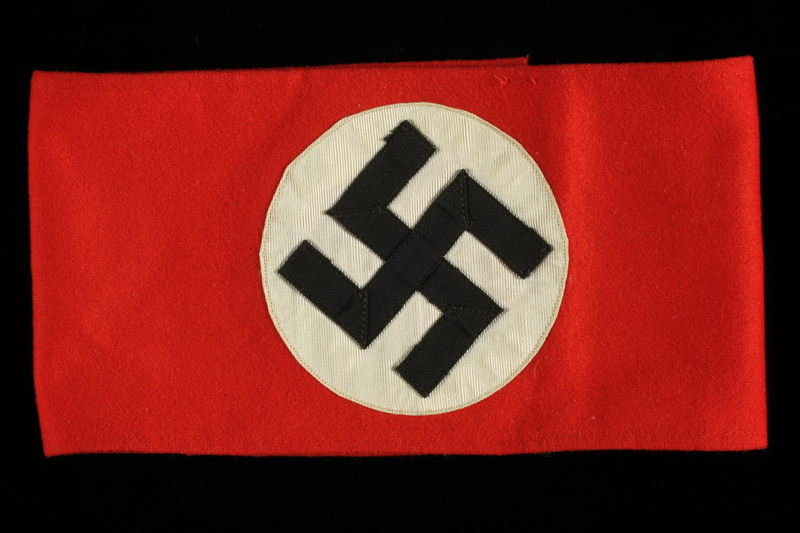 1997.91.1 front Nazi swastika armband acquired by an American POW