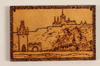 1989.342.14 front Small wooden ornament with a view of a hillside town made by a former Jewish Czech concentration camp inmate  Click to enlarge