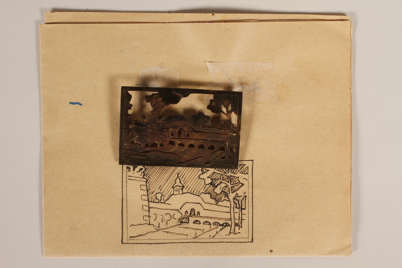 1989.342.15.1-.2 front Pin with a cutout image of the Small Fortress gate at Terezin pinned to paper made by a camp inmate