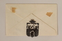 Cutout pendant of the Terezin coat of arms sewn to an envelope made by a former Jewish Czech inmate