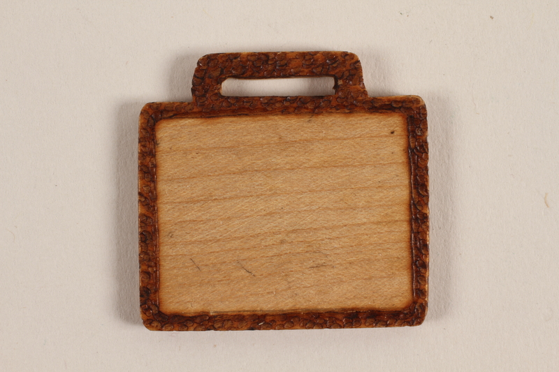 1989.342.2 front Small blank wooden tile made by a former Jewish Czech concentration camp inmate