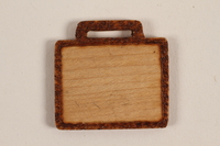 1989.342.2 front Small blank wooden tile made by a former Jewish Czech concentration camp inmate  Click to enlarge