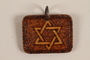 Small wooden pendant with a Star of David made by a former Jewish Czech concentration camp inmate